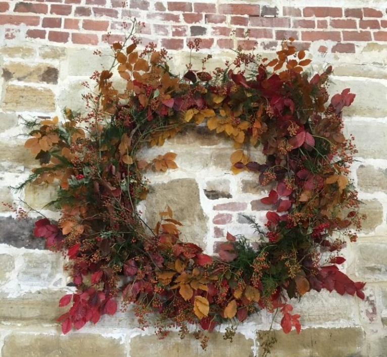 Wreath Decoration on Stone Wall at Hendall, East Sussex Venue